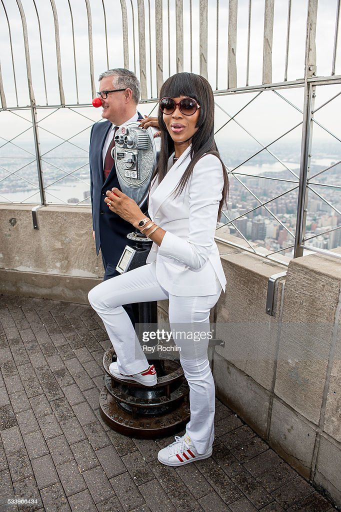 VP Partnerships of Red Nose Day Terry Mills with model Naomi Campbell as she Lights Empire State Building on May 24, 2016 in New York City.