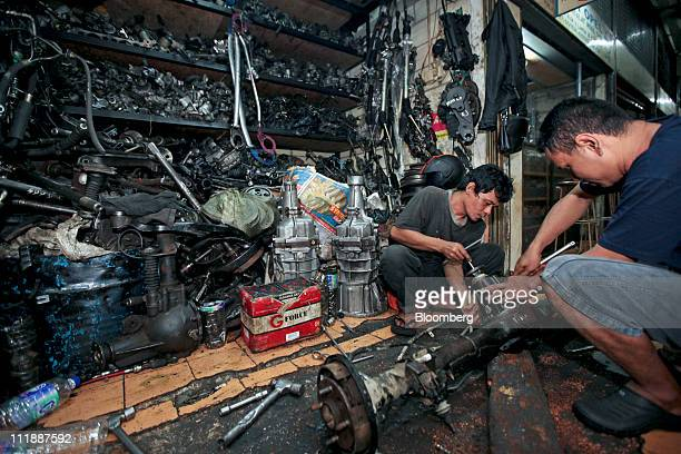 Parts are strewn at a secondhand spare parts shop in the Senen automotive spare parts market in Jakarta Indonesia on Friday April 8 2011 Southeast...