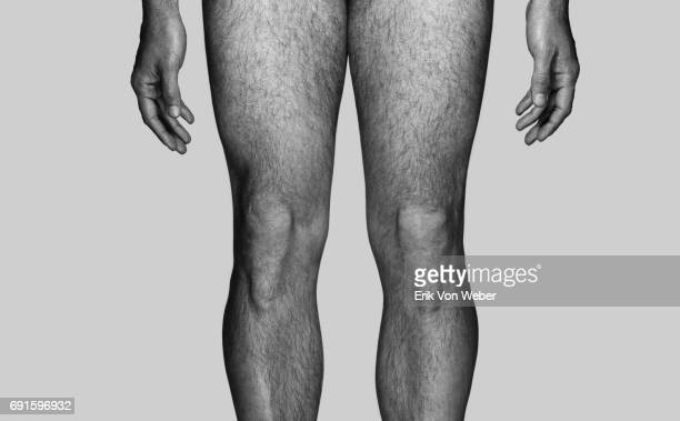 parts of nude body of man on grey background