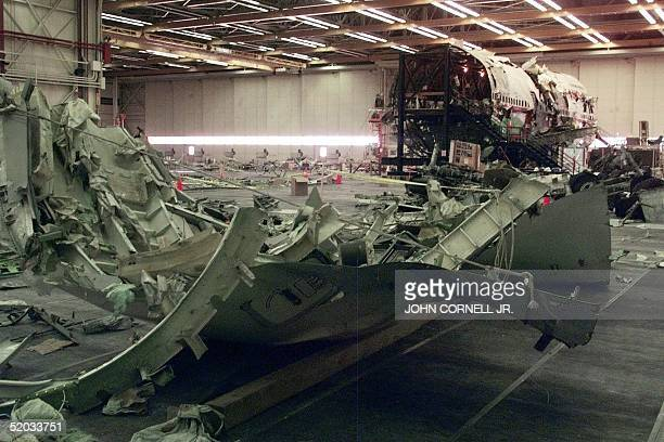 Parts of the wing from the partially reconstructed TWA flight 800 aircraft sit in the hangar 08 July 1999 in Calverton NY The third anniversary of...