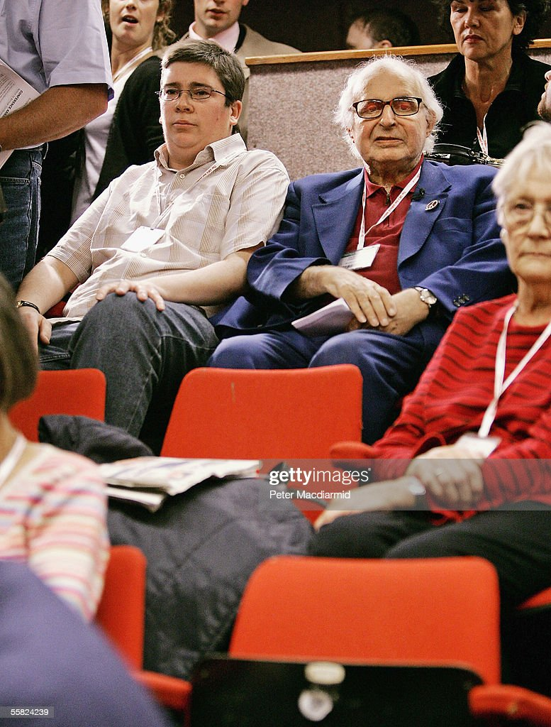 Party activist Steve Forrest (L) and 82-year-old Labour Party member Walter Wolfgang take their seats as they return to the Labour Party conference after being ejected for heckling during the previous day's speech by Foreign Secretary Jack Straw on September 29, 2005 in Brighton, England. The governing Labour Party is holding its yearly conference at the English coastal resort until 29 September, 2005.