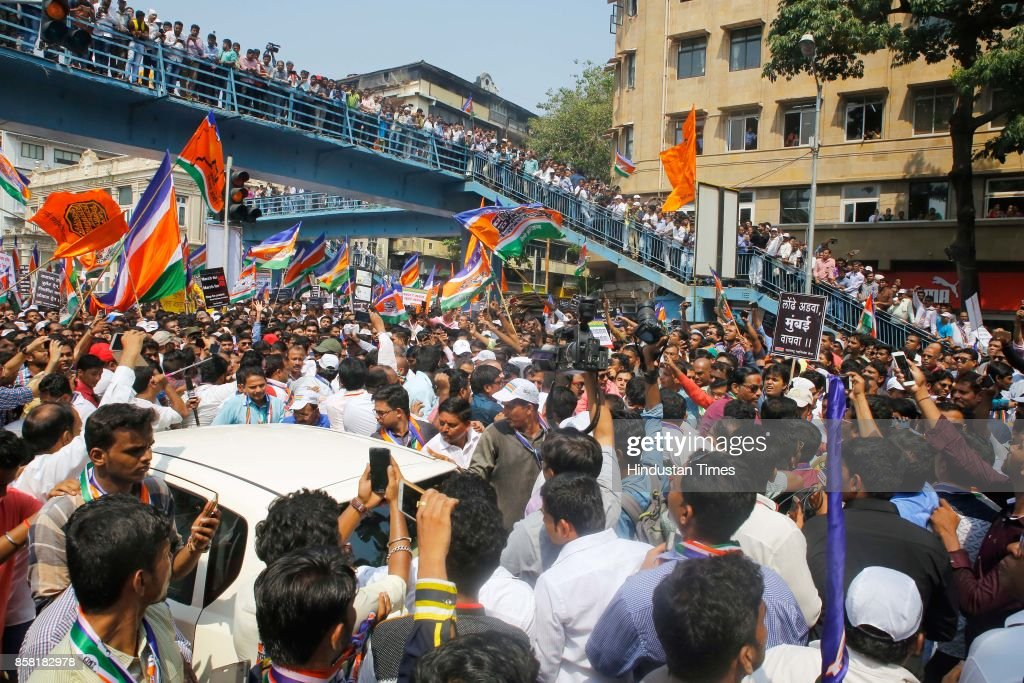 MNS party activists participate in a protest rally from Metro Cinema to Churchgate for better Railway services, on October 5, 2017 in Mumbai, India. Raj Thackeray said while addressing a rally, 'When people in Mumbai leave their homes in the morning, it's not even certain whether they will return home or not. This is unacceptable.'
