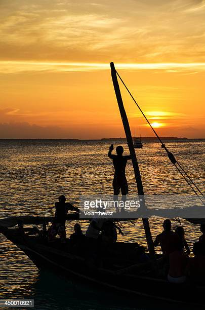 Party at sunset in a traditional boat, Zanzibar