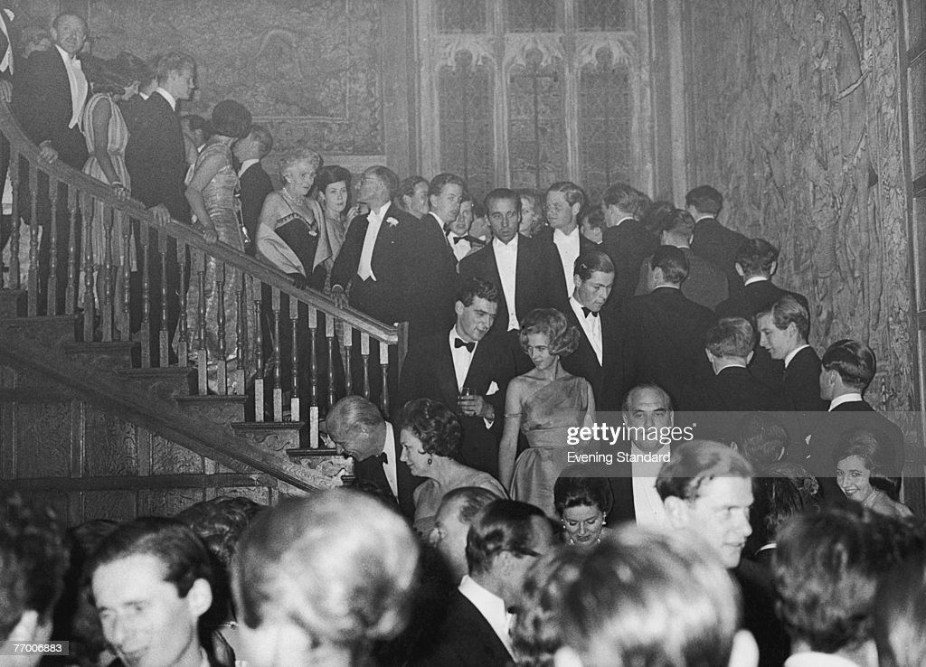 A party at Sutton Place, the Surrey home of American oil tycoon J. Paul Getty, 1st July 1960. The guests queue up for dinner.
