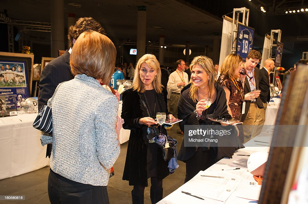 Party attendees look at items up for auction during the 2013 Taste of the NFL>> at the Ernest N. Morial Convention Center on February 2, 2013 in New Orleans, Louisiana.