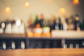 Party background with defocused bottles and glasses
