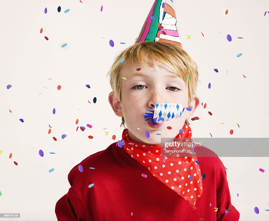 party boy blowing party blower : Stock Photo