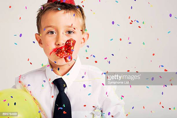 party boy blowing party blower