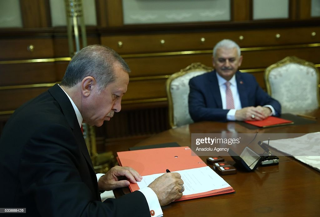 AK party chairman Binali Yildirim (R) meets with Turkish President Recep Tayyip Erdogan (L) at the Presidential palace to submit the list of Cabinet ministers for presidential approval in Ankara, Turkey on May 24, 2016.