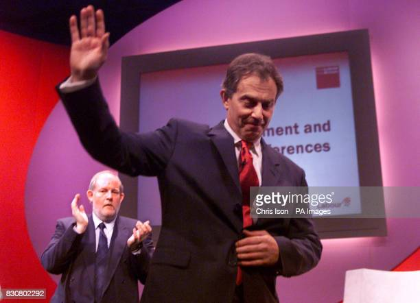 Party Chairman Charles Clarke applauds the Prime Minister Tony Blair as he leaves the podium after speaking at the Labour Party's Local Government...