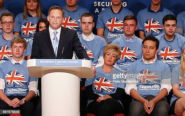 Party chairman Grant Shapps addresses delegates as Mark Clarke looks on at the Conservative party conference on September 28 2014 in Birmingham...