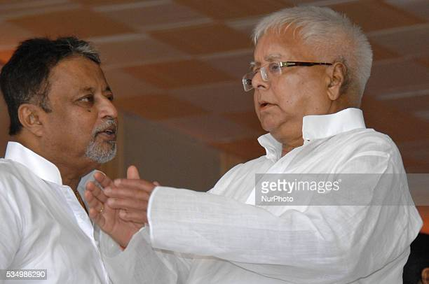 RJD Party Chief Lalu Prasad Yadav and Mukul Roy Trinamool Congress Senior Leader during swearingin ceremony as chief minister of the eastern Indian...