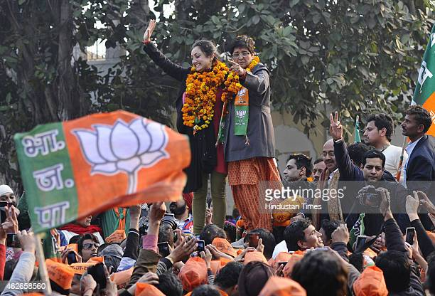 BJP party Chief Ministerial Candidate Kiran Bedi and MP Vijay Goel with party candidate from New Delhi Nupur Sharma during an election campaign road...