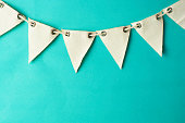 Party decorative fabric garland. Blue colorful background with space for text.