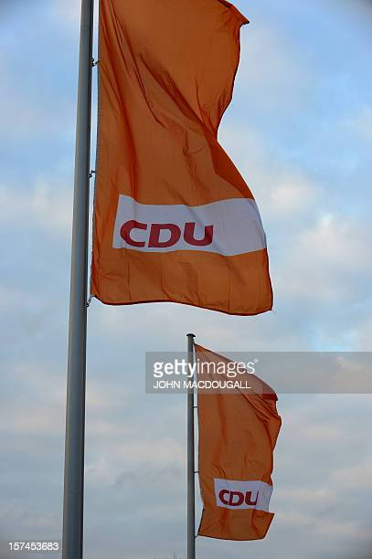 Party flags flutter in front of the venue of the upcoming congress of the ruling conservative Christian Democratic Union party on December 3 2012 in...