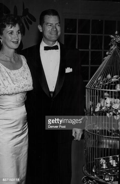 Party goers at a recent gathering at the Denver Country Club Mr and Mrs Barkley Clanahan admire jewels in a Gilded cage Credit The Denver Post