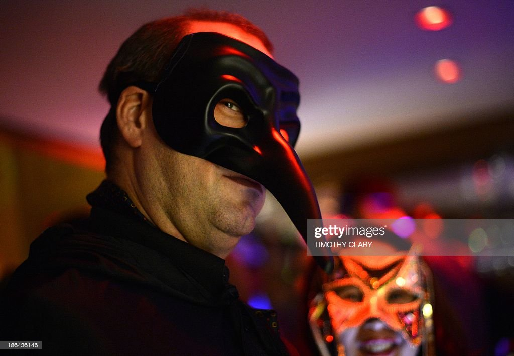 Party goers in masks and costumes attend a Halloween Eve party based on the movie 'Eyes Wide Shut' at Cipriani Wall Street October 30 , 2013. Eyes Wide Shut is a 1999 British-American drama film based upon Arthur Schnitzler's 1926 novella Dream Story. The film was directed, produced, and co-written by Stanley Kubrick.
