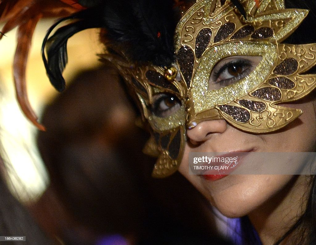 Party goers in masks and costumes attend a Halloween Eve party based on the movie 'Eyes Wide Shut' at Cipriani Wall Street October 30 , 2013. Eyes Wide Shut is a 1999 British-American drama film based upon Arthur Schnitzler's 1926 novella Dream Story. The film was directed, produced, and co-written by Stanley Kubrick. AFP PHOTO / TIMOTHY CLARY