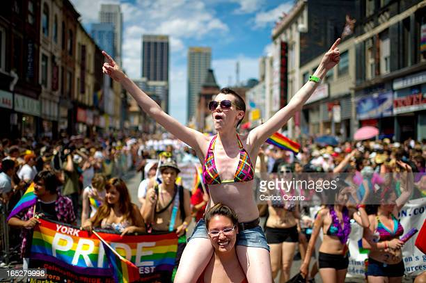 Party goers march in the annual Pride Parade in Toronto on July 3 2011