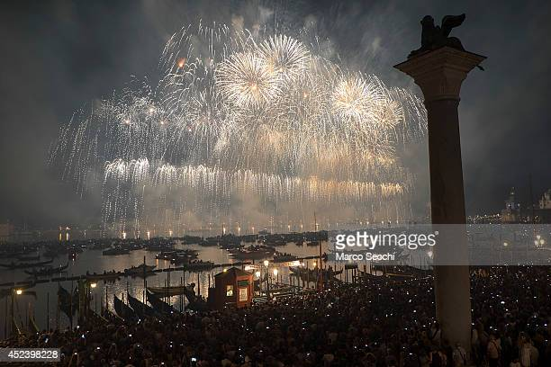 Party goers on gondolas and boats admire the fireworks over the St Mark's Basin for the Redentore Celebrations on July 19 2014 in Venice Italy...