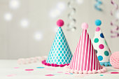 Colorful party hats and confetti