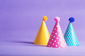 Party hat celebration theme confetti on a bright background
