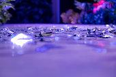 metallic paper spread in a dance floor