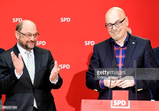 Party leader and Chancellor candidate of Germany's social democratic party SPD Martin Schulz applauds SPD's topcandidate in SchleswigHolstein Torsten...