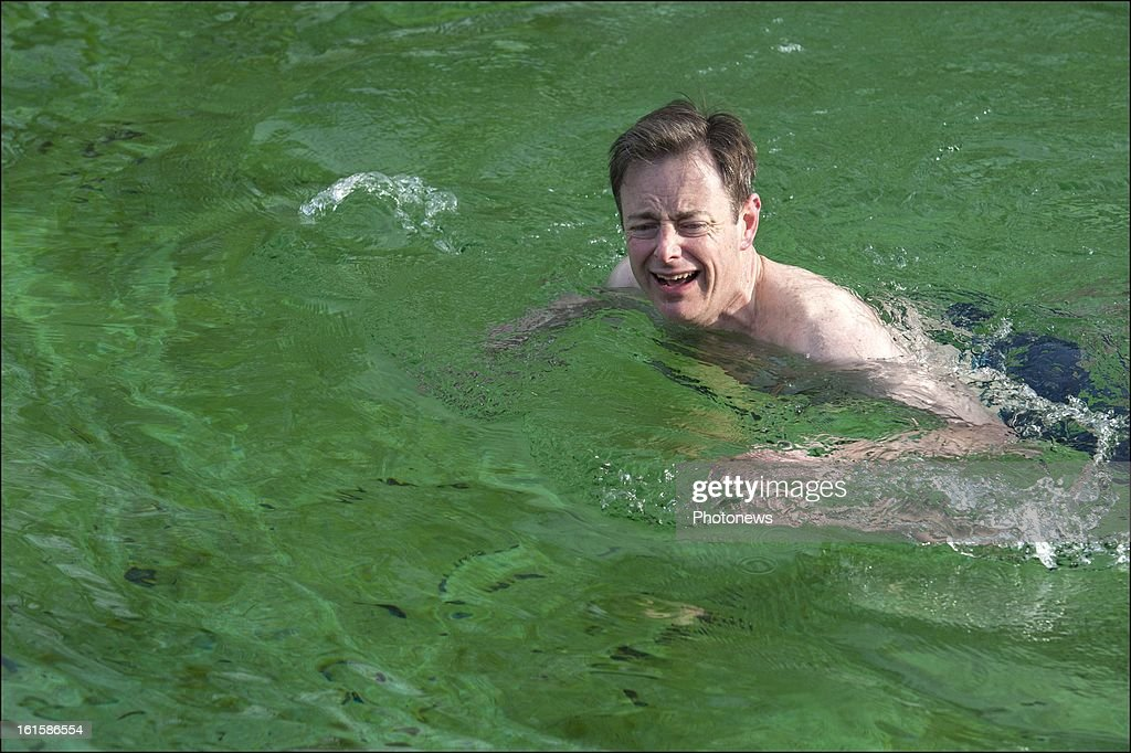 Party Leader and mayor of Antwerp <a gi-track='captionPersonalityLinkClicked' href=/galleries/search?phrase=Bart+De+Wever&family=editorial&specificpeople=4468971 ng-click='$event.stopPropagation()'>Bart De Wever</a> takes a Polar Bear dip on February 10, 2013 in Deurne, Belgium. <a gi-track='captionPersonalityLinkClicked' href=/galleries/search?phrase=Bart+De+Wever&family=editorial&specificpeople=4468971 ng-click='$event.stopPropagation()'>Bart De Wever</a> who used to weigh 142 kg has lost more than 60 kilos the last 12 months.