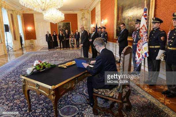 ANO party leader Andrej Babis signs a document after Czech President Milos Zeman appointed him as the countrys new prime minister on December 06 2017...