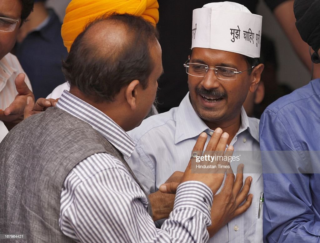 AAP Party leader Arvind Kejriwal having argument with BJP leader Vijender Gupta, during the day long hunger strike by Nirprit Kaur and other women victims of 1984 anti -Sikh riots against acquittal of Sajjan Kumar at Jantar Mantar on May 3, 2013 in New Delhi, India. Sajjan Kumar was acquitted in the case of Anti-sikh riots that broke out 29 years ago on October 31, 1984, after the assassination of then Prime Minister Indira Gandhi.
