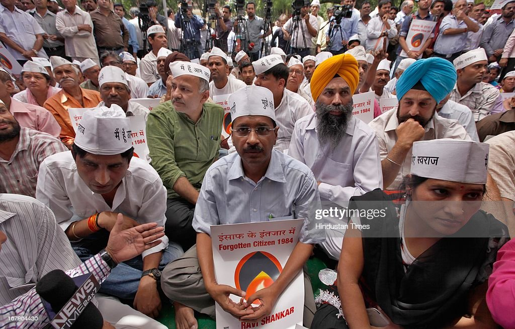 AAP Party leader Arvind Kejriwal sitting down after the argument with BJP leader Vijender Gupta, during the day long hunger strike by Nirprit Kaur and other women victims of 1984 anti -Sikh riots against acquittal of Sajjan Kumar at Jantar Mantar on May 3, 2013 in New Delhi, India. Sajjan Kumar was acquitted in the case of Anti-sikh riots that broke out 29 years ago on October 31, 1984, after the assassination of then Prime Minister Indira Gandhi.