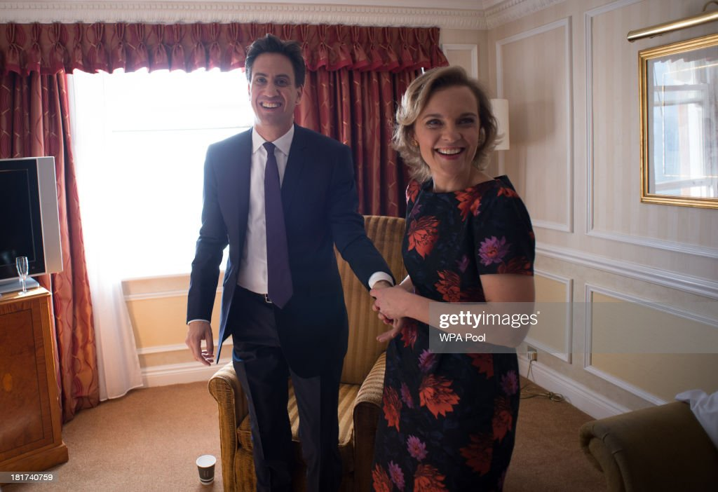 Party leader <a gi-track='captionPersonalityLinkClicked' href=/galleries/search?phrase=Ed+Miliband&family=editorial&specificpeople=4376337 ng-click='$event.stopPropagation()'>Ed Miliband</a> and his wife Justine return to their hotel room after he delivered his keynote speech at the annual Labour party conference on September 24, 2013 in Brighton, England. The Labour leader spoke about the country's 'cost of living crisis' and outlined his party's manifesto pledge to freeze energy bills, cut taxes for small businesses and to build 200,000 new homes a year by 2020.