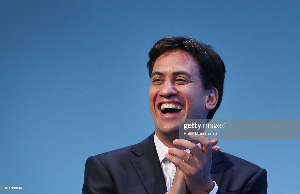Party leader <a gi-track='captionPersonalityLinkClicked' href=/galleries/search?phrase=Ed+Miliband&family=editorial&specificpeople=4376337 ng-click='$event.stopPropagation()'>Ed Miliband</a> laughs during a speech by deputy leader Harriet Harman (unseen) during the Labour Party conference on September 25, 2013 in Brighton, England. Mr Miliband took part in a question and answer session on the last day of conference.