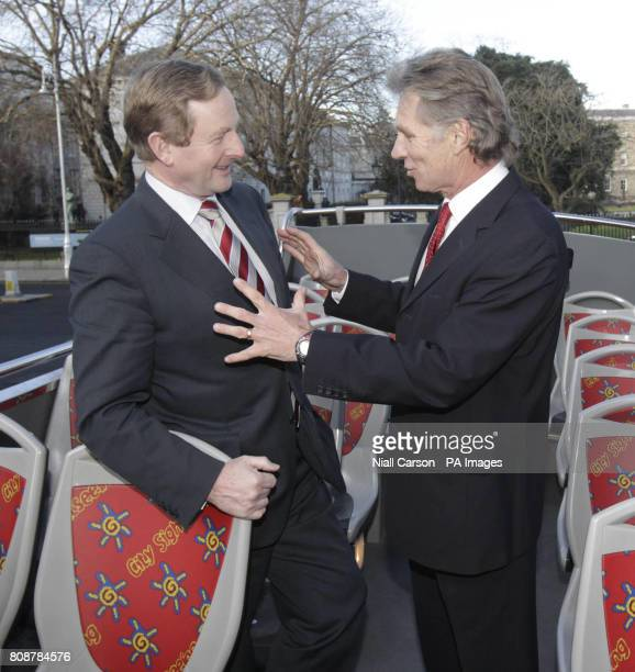 Party leader Enda Kenny and Eamonn Coghlan launch Fine Gael's tourism strategy on top of a sightseeing tour bus in Merrion Square Dublin