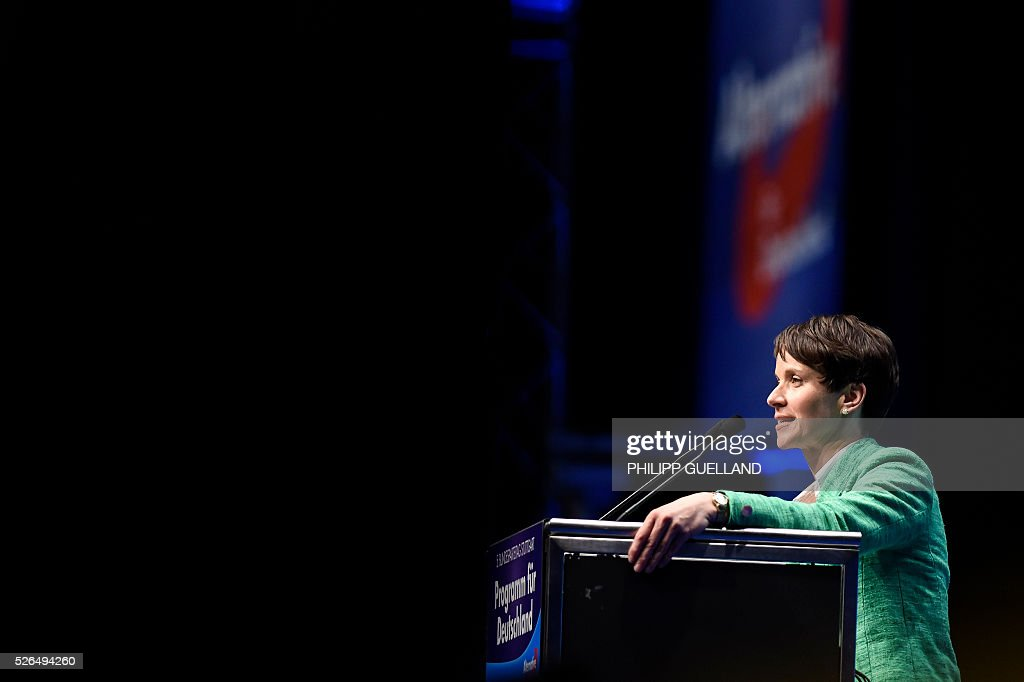 AFD party leader Frauke Petry delivers a speech during a party congress of the German right wing party AfD (Alternative fuer Deutschland) at the Stuttgart Congress Centre ICS on April 30, 2016 in Stuttgart, southern Germany. The Alternative for Germany (AfD) party is meeting in the western city of Stuttgart, where it is expected to adopt an anti-Islamic manifesto, emboldened by the rise of European anti-migrant groups like Austria's Freedom Party. / AFP / Philipp GUELLAND