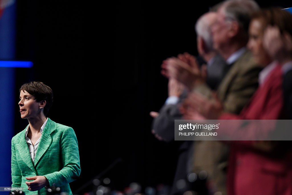 AFD party leader Frauke Petry reacts after delivering a speech during a party congress of the German right wing party AfD (Alternative fuer Deutschland) at the Stuttgart Congress Centre ICS on April 30, 2016 in Stuttgart, southern Germany. The Alternative for Germany (AfD) party is meeting in the western city of Stuttgart, where it is expected to adopt an anti-Islamic manifesto, emboldened by the rise of European anti-migrant groups like Austria's Freedom Party. / AFP / Philipp GUELLAND