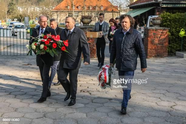 PO party leader Grzegorz Schetyna Slawomir Neumann and Jacek Karnowski are seen on 10 April 2017 in Gdansk Poland at Srebrzysko cemetery Politicians...