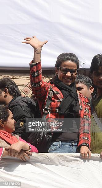 AAP party leader Gul Panag waving to AAP supporters in New Delhi