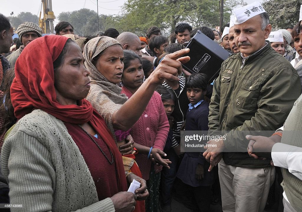 AAP Party leader Manish Sisodia addressing the residents as DDA officials came to demolish the Jhuggies along the Yamuna River near Mayur Vihar on December 20, 2013 in New Delhi, India.