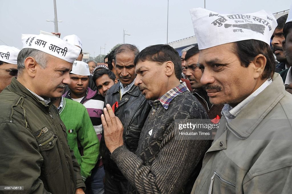 AAP Party leader Manish Sisodia talking to DDA officials and police, as DDA officials came to demolish the Jhuggies along the Yamuna River near Mayur Vihar on December 20, 2013 in New Delhi, India.