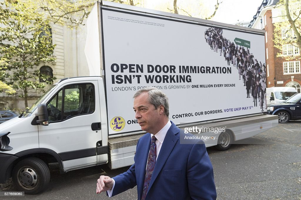 UKIP party leader Nigel Farage stands in front of the final UKIP party election campaign poster for London Elections focussing on immigration in London, United Kingdom on May 03, 2016.