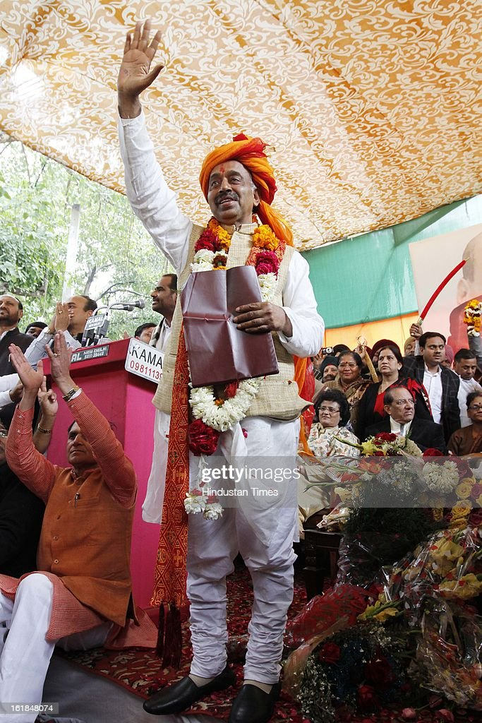 Party leaders greet their Newly appointed BJP Delhi Pradesh President Vijay Goel at a function at BJP office on February 17, 2013 in New Delhi, India.