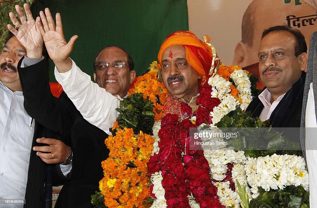 Party leaders greet to their Newly appointed BJP Delhi Pradesh President Vijay Goel as former president of BJP Delhi pradesh Vijender Gupta looks on at a function at BJP office on February 17, 2013 in New Delhi, India.