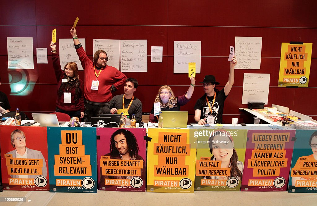 Party members lift their voting cards at the federal party convention of the German Pirates Party (Die Piratenpartei) on November 24, 2012 in Bochum, Germany. The Pirates, after riding an initial surge in popularity last year that landed them seats in several German state parliaments, have since seen their popularity erode as recent scandals and infighting have tarnished the party's image. Germany faces federal elections in 2013.