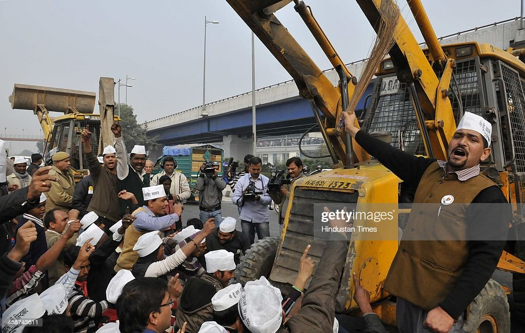 AAP Party members protest against DDA Officials, as DDA Officials came to demolish the Jhuggies along the Yamuna River near Mayur Vihar on December 20, 2013 in New Delhi, India.