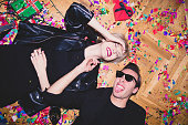 New Year's / Birthday Party. Girl and boy laying on the floor full of confetti