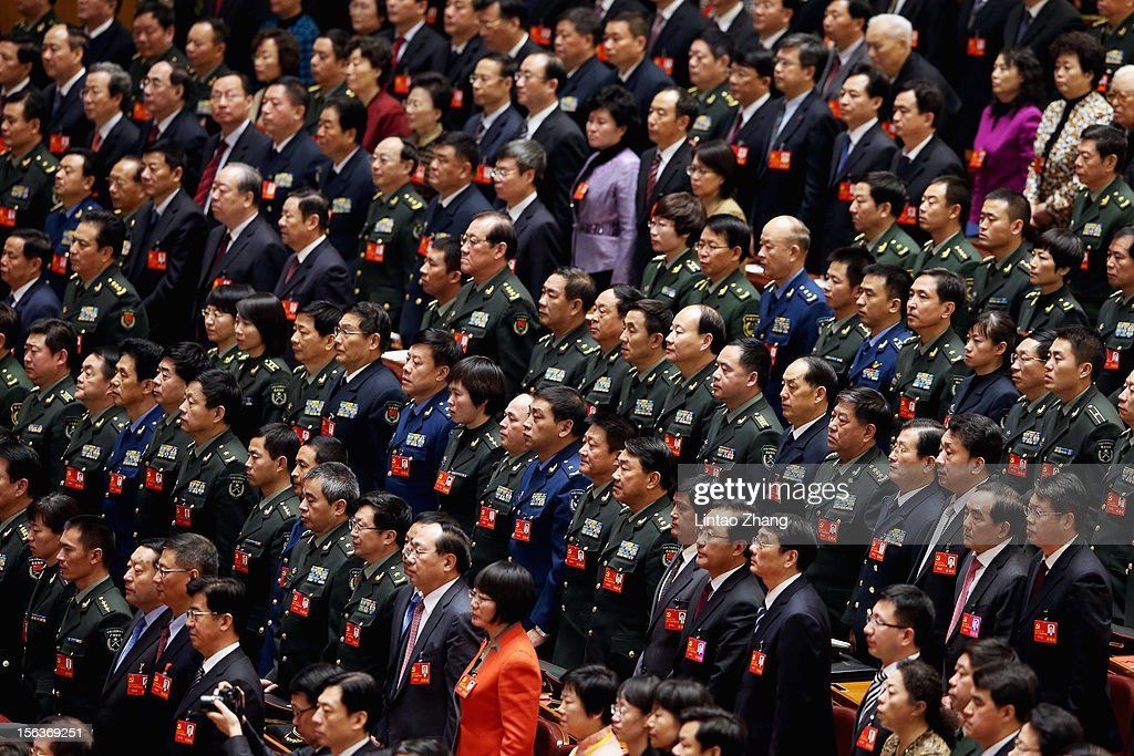 Party representatives stand during the closing of the 18th Communist Party Congress at the Great Hall of the People on November 14, 2012 in Beijing, China. The Communist Party Congress will convene from November 8-14 and will determine the party's next leaders.