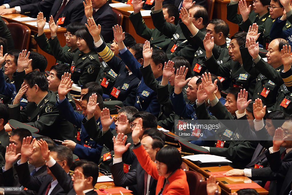 Party representatives vote during the closing of the 18th Communist Party Congress at the Great Hall of the People on November 14, 2012 in Beijing, China. The Communist Party Congress will convene from November 8-14 and will determine the party's next leaders.