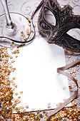 venetian mask and confetti with blank paper for your text